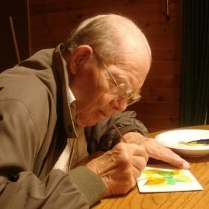 elderly man creating a watercolor