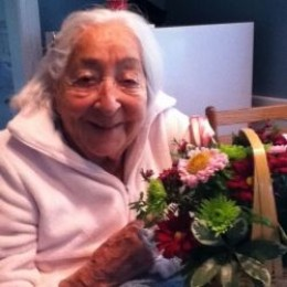 94 year old woman with flowers