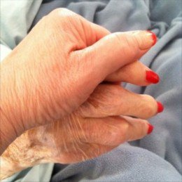 holding hands with a senior citizen