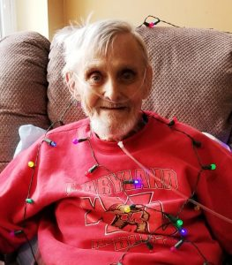 94 year old man in christmas lights